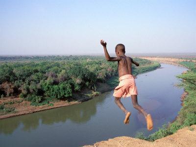 https://imgc.artprintimages.com/img/print/karo-boy-leaps-off-a-cliff-over-the-omo-river-ethiopia_u-l-p484pz0.jpg?p=0