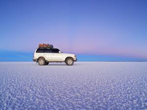 Bolivia, Potosi Department, Daniel Campos Province, White Toyota Landcruiser on the Salar de Uyuni, by Karol Kozlowski