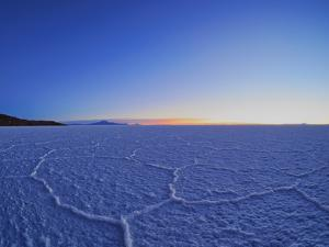View of the Salar de Uyuni, the largest salt flat in the world, at sunrise, Daniel Campos Province, by Karol Kozlowski