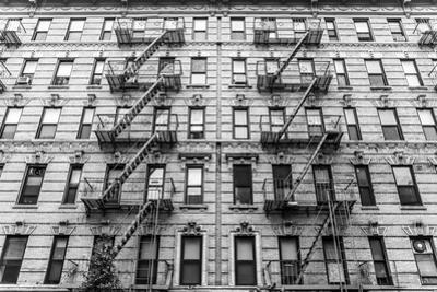 A Fire Escape of an Apartment Building in New York City by kasto