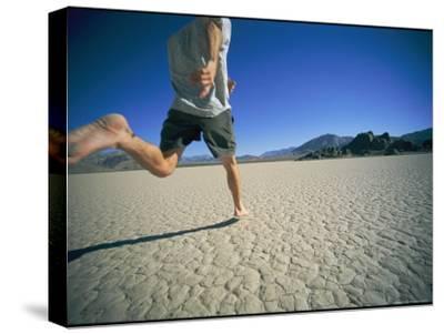 A Man Runs Barefoot Across the Desert in Death Valley
