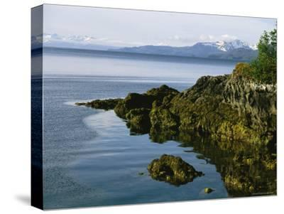 Algae-Covered Rocks, Snow-Covered Mountains Around Prince Willam Sound