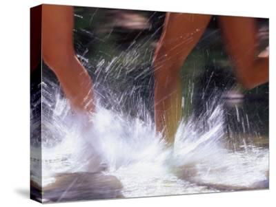 Runners Splashing Through Water, Sedona, Arizona