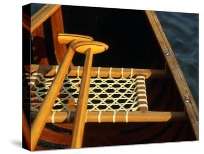 Wooden Paddles Inside a Canoe, California