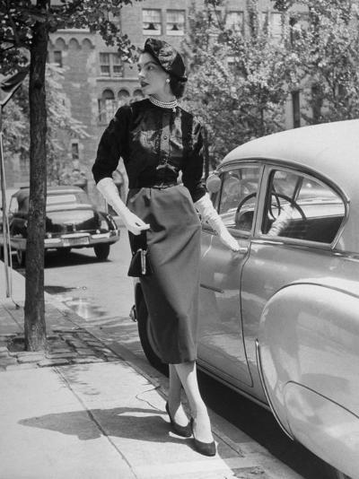 Katherine Cassidy Wearing a Red Fraostmann Wool Skirt and Black Sweater Beneath Black Cardigan-Nina Leen-Photographic Print