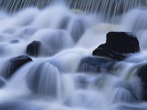 Close-Up of Waterfall, Water Cascading over Rocks in the Highlands of Scotland, United Kingdom by Kathy Collins