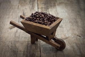 Coffee Beans In A Wheelbarrow by kbuntu