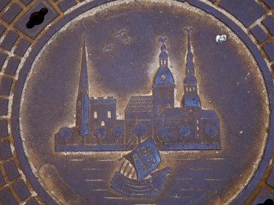 Latvia, Riga, Manhole Cover in Street, Close-up