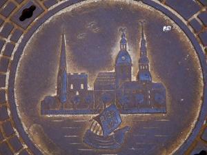 Latvia, Riga, Manhole Cover in Street, Close-up by Keenpress