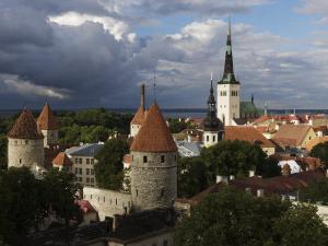 Medieval Town Walls and Spire of St. Olavs Church, Tallinn, Estonia, Baltic States, Europe by Keenpress