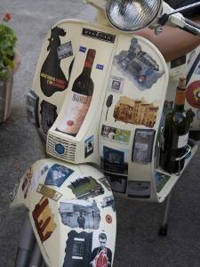 Scooter Covered with Wine Labels and Stickers by Keenpress