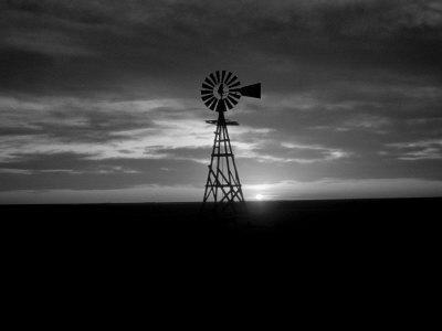 Silhouette of an Old Style Windmill During Sunset