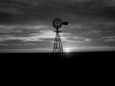 Silhouette of an Old Style Windmill During Sunset by Keenpress