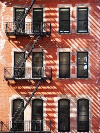 A Red Brick Building with a Fire Escape Off of Union Square by Keith Barraclough