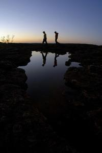 A Man and a Woman Hiking at Sunset in the Cederberg Wilderness Area, South Africa by Keith Ladzinski