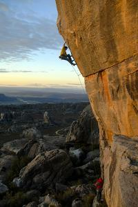 A Man Climbs the Sheer Face of a Cliff in Cederberg Wilderness Area by Keith Ladzinski