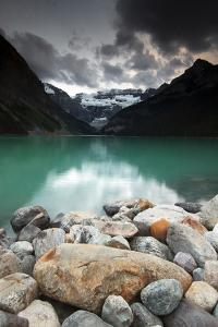 A Pile of Smooth Rocks on the Shore of Lake Louise in Banff National Park by Keith Ladzinski