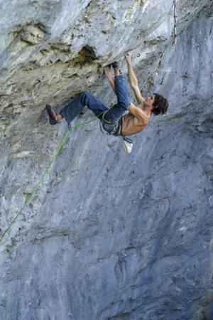 Looking Down Upon a Man Rock Climbing by Keith Ladzinski