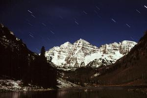 Maroon Bells at Night, with Shooting Stars in the Sky by Keith Ladzinski