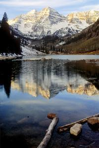 Maroon Bells in Winter Reflected in Maroon Lake by Keith Ladzinski