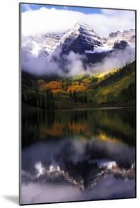Maroon Bells with Fog and Autumn Aspens Reflected in Maroon Lake by Keith Ladzinski