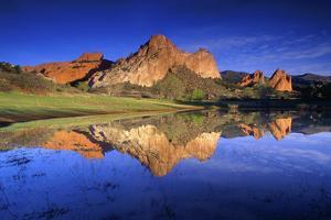 Reflection of Rock Formations in Lake, Garden of the Gods, Colorado by Keith Ladzinski