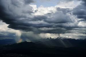 Storm Clouds and a Rainbow Appear Above Mountains in Verdon Gorge by Keith Ladzinski
