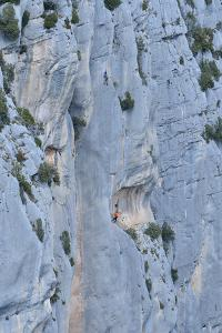Two Climbers Scale a Step Cliff in the Verdon Gorge, France by Keith Ladzinski