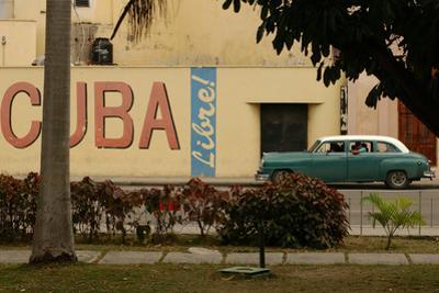 Side Profile of a Vintage Car on an Empty Street, Havana, Cuba