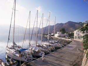 Yachts, Livadhia, Island of Tilos, Dodecanese, Greece by Ken Gillham