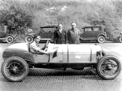 https://imgc.artprintimages.com/img/print/ken-schoenfeld-with-racecar-in-seattle-photograph-seattle-wa_u-l-q1gnsuv0.jpg?p=0