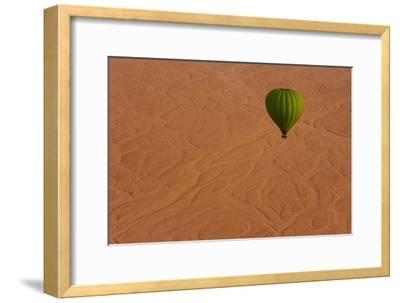 A Hot Air Balloon Soars Above the Desert Beyond the Theban Mountain