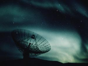 A Satellite Dish Silhouetted against the Northern Lights by Kenneth Garrett