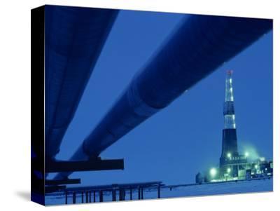 Alaska Oil Pipeline and Oil Rig at Night