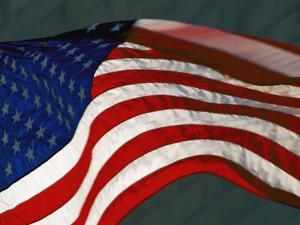 Close View of One of the American Flags Surrounding the Washington Monument by Kenneth Garrett