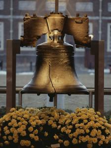 Close View of the Liberty Bell, and Flowers Beneath It by Kenneth Garrett