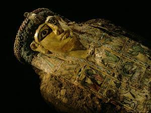 Gilded Mummy with Greek Spiral Curls and Traditional Egyptian Motifs, Bahariya Oasis, Egypt by Kenneth Garrett