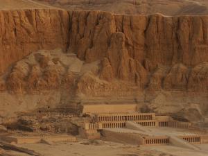 Hatshepsut's Mortuary Temple Rises Against a Desert Bluff by Kenneth Garrett