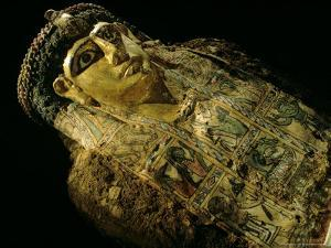 Mummy A with Gilded Mask and Cartonnage Chest Plate, Valley of the Golden Mummies, Egypt by Kenneth Garrett