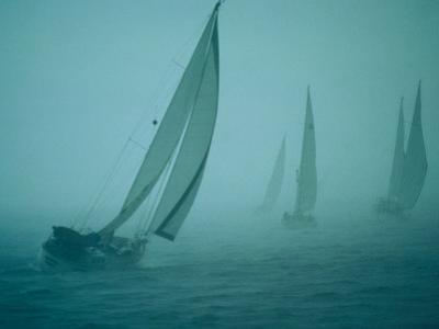 Sailboats Leaning in the Wind and Heavy Fog