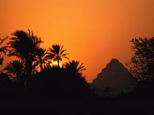 The Step Pyramid of Djoser Silhouetted by the Setting Sun by Kenneth Garrett