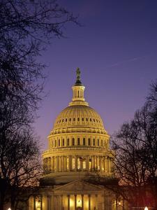 The U.S. Capitol Building Lit Up at Night, Washington, D.C. by Kenneth Garrett