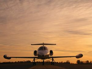 Twilight View of a Lear Jet on the Runway by Kenneth Garrett