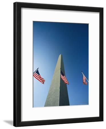 View from the Ground of the Washington Monument and American Flags