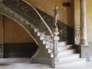 A Circular Marble Staircase and Statue in Central in Central Havana by Kenneth Ginn