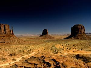A Sun-Scorched Monument Valley in the Afternoon by Kenneth Ginn