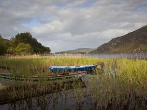 An Afternoon Landscape of a Lake with Rowboats in the Foreground by Kenneth Ginn