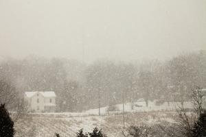 A Farmhouse at the Beginning of a Snow Storm That Dumped 11.3 Inches of Snow in the Area by Kent Kobersteen