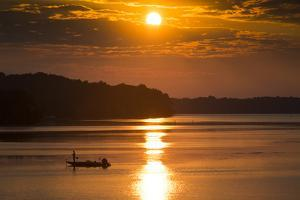 A Fisherman at Sunrise on the Occoquan River, Looking Toward Mason Neck by Kent Kobersteen