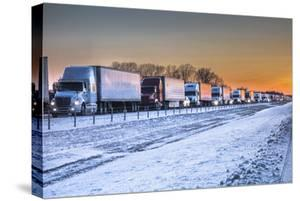 A Ten-Mile Backup of Cars and Trucks Due to Icy Conditions on Eastbound Interstate 40 by Kent Kobersteen
